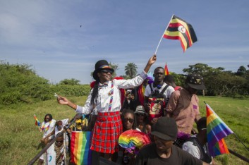 People waving Ugandan and rainbow flags take part in the Gay Pride parade in Entebbe on August 8, 2015 Isaac Kasamani / AFP / Getty Images