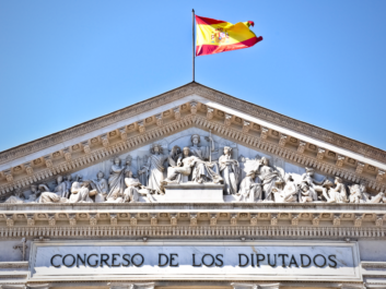Spanish Congress with a waving Spanish flag